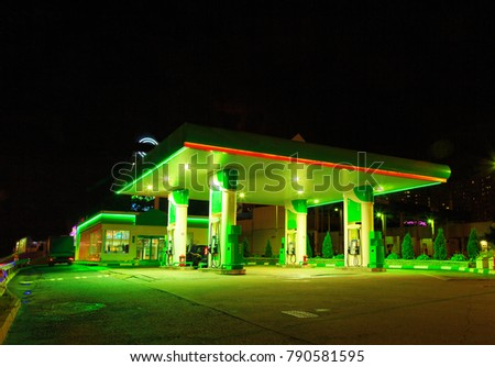Petrol gas station station at night with lights on and mini-mart  #790581595