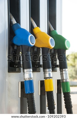 petrol pump, blue, yellow and green colors - stock photo
