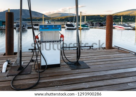 Petrol Pump for Boats in a Harbour on a Mountain Lake at Sunset #1293900286