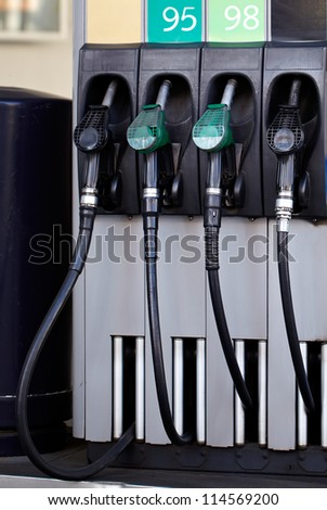 """Petrol pump with the sign """"95 and 98"""" benzine. - stock photo"""