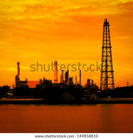 Petroleum oil refinery factory near riverside in Thailand, warm tone