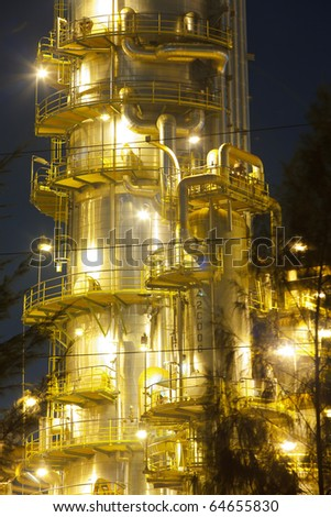 Petroleum refinery distiller column at night