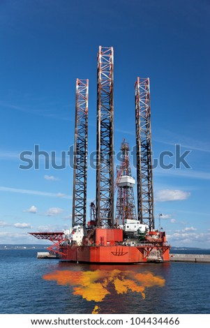 Petroleum spill from the oil rig. - stock photo