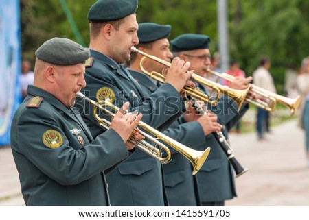 Petropavlovsk, Kazakhstan - June 4, 2019: Day of state symbols of the Republic of Kazakhstan. Holiday children and adults celebrate. Athletes and musicians in the park in the park. #1415591705