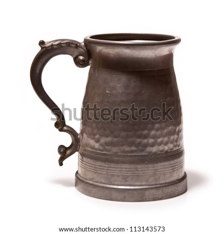 Pewter beer tankard isolated on a white studio background.