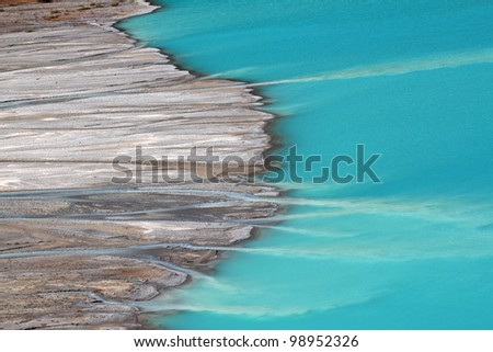 Peyto Glacier meltwater flows into Peyto Lake in Banff National Park - Canada