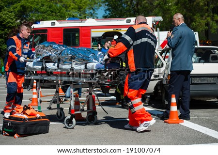 PEZINOK, SLOVAKIA - MAY 4, 2014: Search and rescue operation during simulated car accident in Pezinok, Slovakia