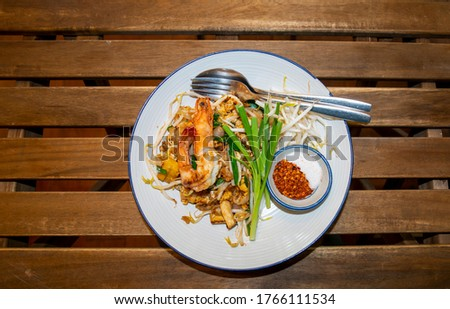 Phad Thai with fresh prawns, kuicheai and granulated sugar and chili ready for searved.famous Thai's dish Phad thai. Fried noodle with shrimp.Thai noodle style.Pad thai shrimp hugely popular dish.