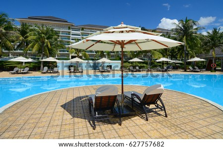 Phan Thiet, Vietnam - Oct 14, 2015. Swimming pool at luxury resort in Phan Thiet, Vietnam. Phan Thiet is a coastal city famous for many luxury resorts runing along the coast. #627757682
