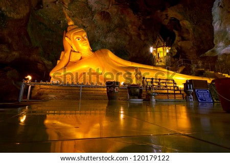 PHANG NGA, THAILAND - NOV 8: Wat Tham Suwan Khuha cave. This natural temple with fifteen meters long golden reclining Buddha is a tourist attraction in Phang Nga, Thailand on Nov. 8, 2012.