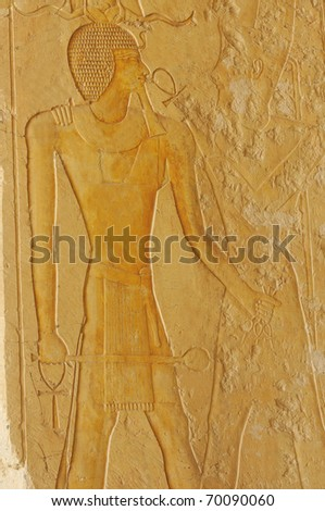 http://image.shutterstock.com/display_pic_with_logo/255850/255850,1296413358,3/stock-photo-pharaoh-tuthmoses-iii-wearing-the-ram-s-horn-crown-holds-ankh-s-in-his-hands-while-receiving-the-70090060.jpg