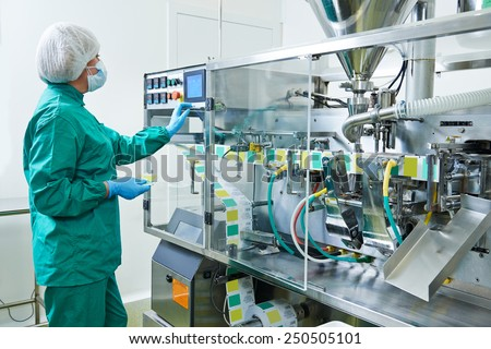 pharmaceutical factory woman worker operating production line at pharmacy industry manufacture factory