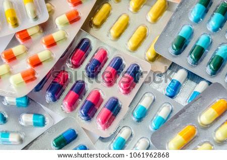 pharmaceuticals antibiotics pills medicine /colorful antibacterials pills on  white background /capsule pill medicine