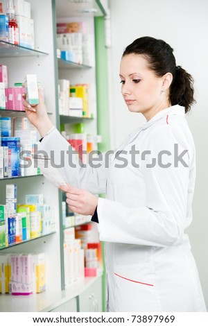 pharmacist chemist woman working in pharmacy drugstore