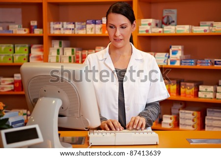Pharmacist making an online order in a pharmacy