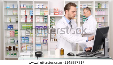 Pharmacist Man Talking with His Colleague About Ordering Drugs n Pharmacy Shop or Drugstore Interior, Pharmaceutical Store Concept