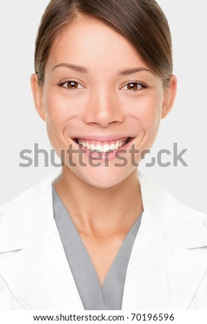 Pharmacist. Portrait of young professional woman pharmacist or scientist in lab coat. Smiling mixed race Caucasian / Asian woman.
