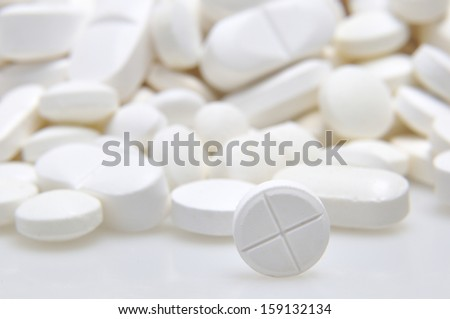 Pharmacy background, Heap of white round medicine tablets