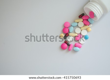Pharmacy background on a wood table.Pills. Medicine and healthy. Close up of capsules. Different kind of medicines