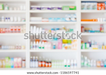 Pharmacy drugstore blur abstract background with medicine and healthcare product on shelves