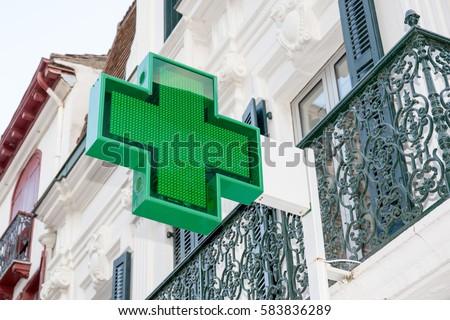 Pharmacy sign on the wall under deep blue sky #583836289