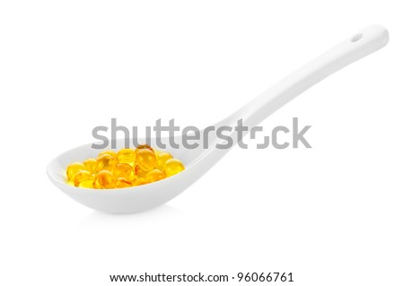 Pharmacy. Vitamin pills in spoon on white background