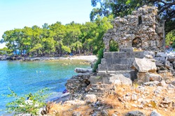 Phaselis ancient city in Kemer of Antalya. Glorious beaches, calm sea, fab snorkelling and all set within ancient ruins that set the imagination. Very nice and historical place very quiet beach.