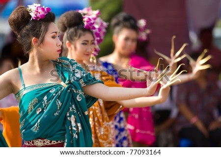 PHAYAO, THAILAND - MARS 05: Unidentified Thai dancer  perform Thai dance  during festival in honor of Phayao founder King Ngam Muang  on March 05, 2011 in Phayao, Thailand. - stock photo