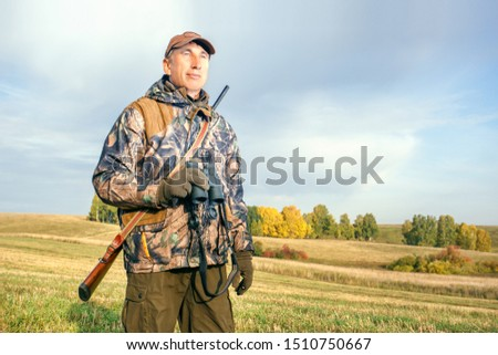 Pheasant Hunter. Man Hunter in autumn.