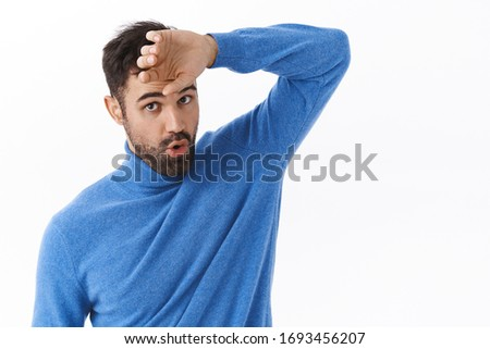 Phew that was close. Portrait of relieved handsome bearded man wiping sweat from forehead and exhale as got rid of problem, finished task, feeling exhausted, standing white background Stock photo ©