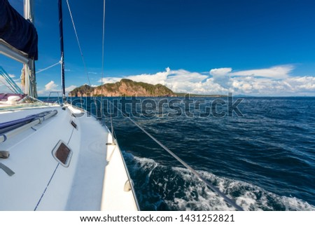 Phi Phi island - view from the sea with a sailing yacht cruise. Blue sea and famous rocky tropical island Phi Phi Don near Phuket, Thailand