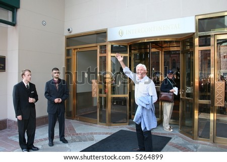 Phil Donahue waves to fans as he leaves his hotel during the Toronto Film Festival