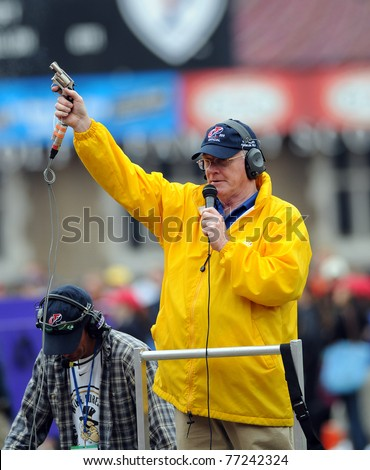 PHILADELPHIA - APRIL 29: A race official holds a starter's pistol in the air waiting to start a hurdles race at the 117th Penn Relays April 29, 2011 in Philadelphia