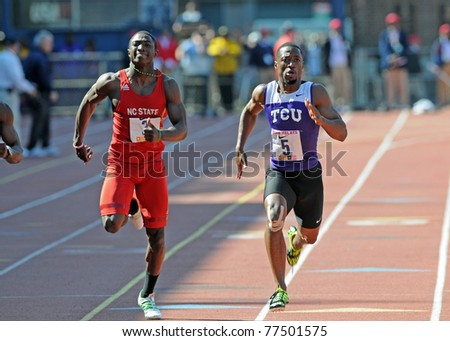 PHILADELPHIA - APRIL 30: Charles Silmon from TCU (R) & T.J. Graham from N.C. State (l) are neck and neck in College Men's 100 meter Dash Championship at the 117th Penn Relays in Philadelphia.