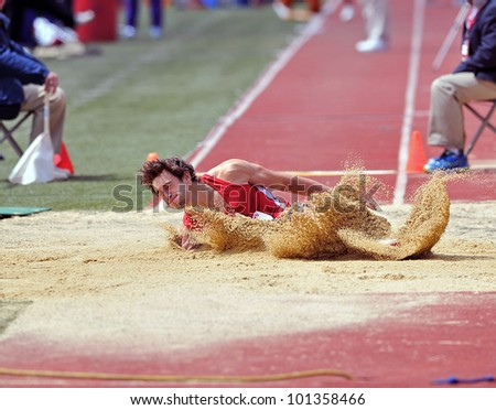 PHILADELPHIA - APRIL 27: Corey Crawford from Rutgers lands in the sand on a long jump attempt during the 2012 Penn Relays April 27, 2012 in Philadelphia.
