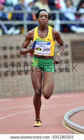 PHILADELPHIA - APRIL 28: Korene Hinds  from Jamaica runs in the Olympic Development sprint medley relay at the 2012 Penn Relays April 28, 2012 in Philadelphia. - stock photo