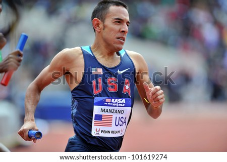 PHILADELPHIA - APRIL 28: Leo Manzano  from the USA runs the anchor leg of the USA vs the World distance Medley at the Penn Relays April 28, 2012 in Philadelphia.