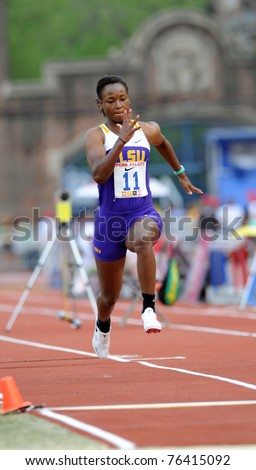 PHILADELPHIA - APRIL 28: LSU long jumper Jennifer Clayton sprints down the runway preparing to jump during the ladies college competition at the 117th Penn Relays on April 28, 2011 in Philadelphia, PA