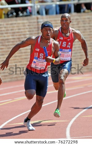 PHILADELPHIA - APRIL 30: Mike Rodgers (foreground) takes the baton from Trell Kimmons for USA Red in the USA vs the World 4x100 relay at the 2011 Penn Relays in Philadelphia, PA.