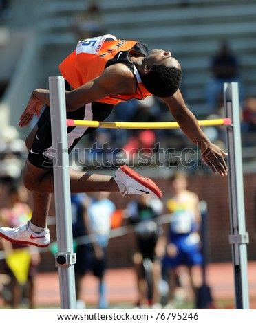 PHILADELPHIA - APRIL 29: Princeton high jumper Omar Jarrett attempts to clear the bar early in the Eastern College Men's High Jump Competition at the 117th Penn Relays on April 29, 2011 in Philadelphia, PA - stock photo