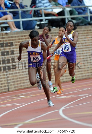 PHILADELPHIA - APRIL 28: Rebecca Alexander (r) from LSU approaches the final hand-off in the first heat of the 4x100 women's relays at the 117th Penn Relays April 28, 2011 in Philadelphia