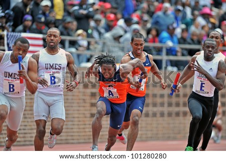 PHILADELPHIA - APRIL 28: The Syracuse 4x100 men's relay team (A) makes the final baton exchange during the ECAC championships at the 2012 Penn Relays April 28, 2012 in Philadelphia.