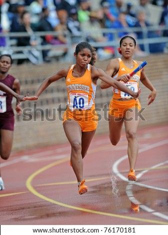 PHILADELPHIA - APRIL 28: Two members of the Tennessee ladies 4x100 relay team prepare to pass the baton at the 2011 Penn Relays winning the event April 28, 2011 in Philadelphia, PA