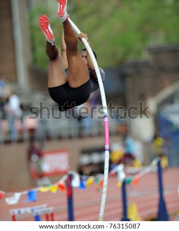 PHILADELPHIA - APRIL 28: Unidentified ladies college pole vaulter goes up for a practice session prior to the competition at the 177th Penn Relays on April 28, 2011 in Philadelphia, PA