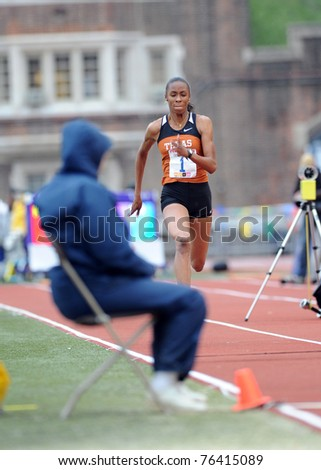 PHILADELPHIA - APRIL 28: University of Texas long jumper Chantel Malone sprints down the runway for a jump during the ladies college competition at the 117th Penn Relays on April 28, 2011 in Philadelphia, PA