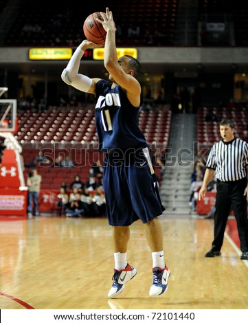PHILADELPHIA - DECEMBER 12: Akron University basketball guard Alex Abreu goes up for a long three point shot in a game against Temple December 12, 2010 in Philadelphia.