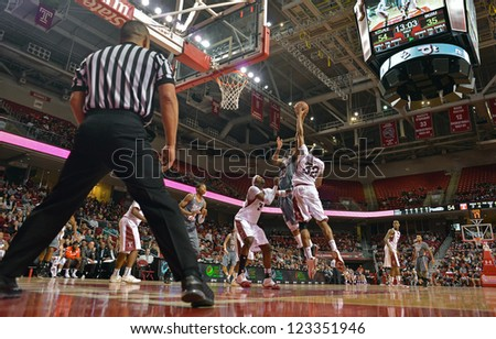 PHILADELPHIA - DECEMBER 31: An official watches the action as Temple and Bowling Green player battle in the lane during the basketball game December 31, 2012 in Philadelphia.