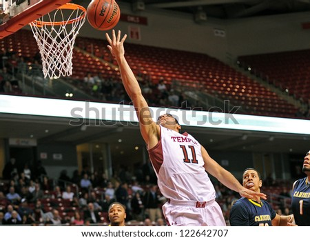 PHILADELPHIA - DECEMBER 19: Temple Owls guard T.J. DiLeo (11) shoots a reverse lay-up during the Gotham City Classic game against Canisius December 19, 2012 in Philadelphia.