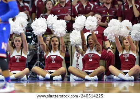 PHILADELPHIA - DECEMBER 22: The Temple Owls cheerleaders cheer on their team from the baseline during the NCAA basketball game December 22, 2014 in Philadelphia.
