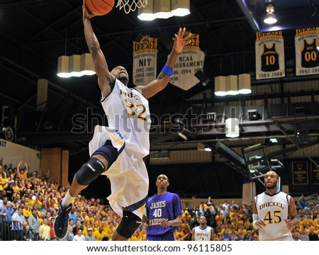 PHILADELPHIA - FEB 22: Drexel Dragons guard Derrick Thomas (32) elevates for a dunk during the NCAA basketball game between Drexel and James Madison February 22, 2012 in Philadelphia